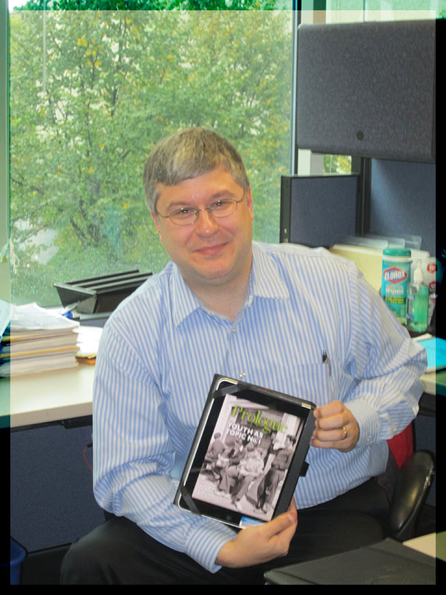 Arian displays an issue of Prologue on his iPad.