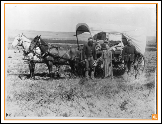 Photograph of a Family with Their Covered Wagon During the Great Western Migration, 1866