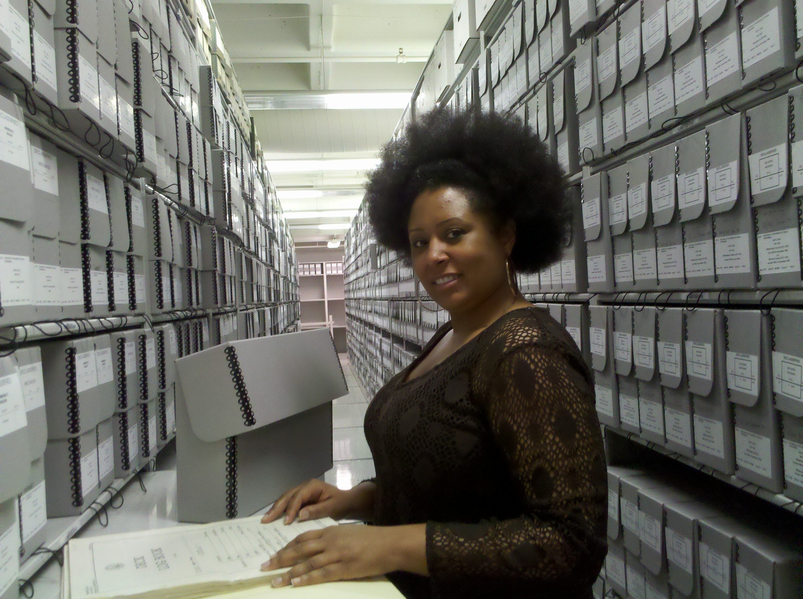 Tina Ligon views Navy Deck logs in the stacks at the National Archives in College Park, Maryland